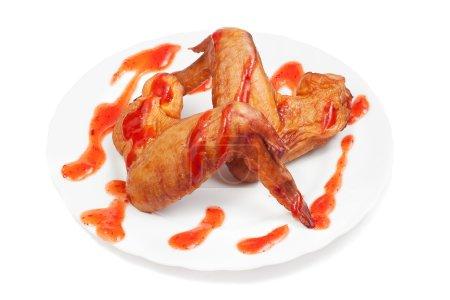 Photo pour Ailes de poulet fumé sur fond blanc - image libre de droit