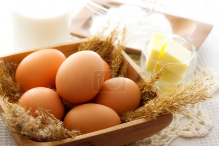 Photo for Cake making ingredients - eggs, butter, milk and flour - Royalty Free Image