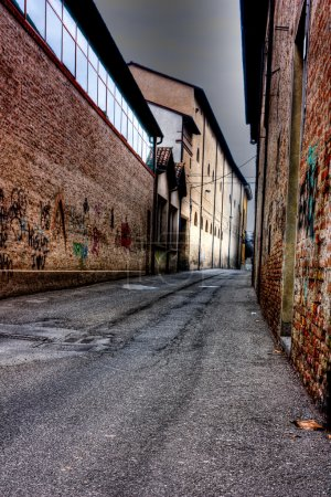 Photo for Street in the twilight, night is falling in the decadent old town, grunge dark alley at dusk, evening in slums of the city, urban decay - Royalty Free Image