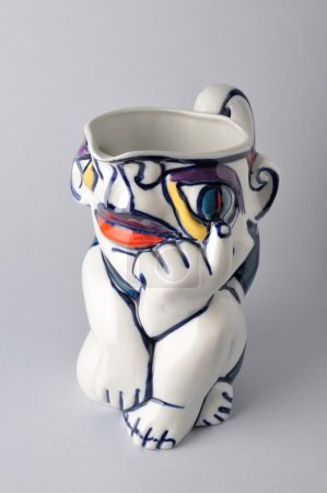 Ceramic jug decorated with abstract painting.
