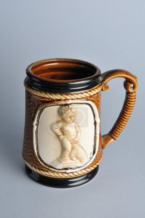 "Mug decorated with "" Manneken Pis ""."