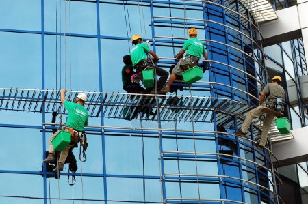 Workers washing the windows facade