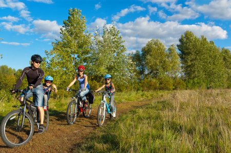 Photo for Happy parents with two kids on bikes. Family sport - Royalty Free Image