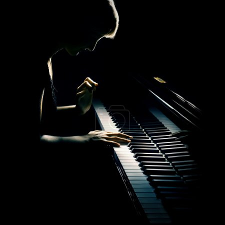 Photo for Piano playing pianist concert. Classical music musician player with grand piano in darkness - Royalty Free Image