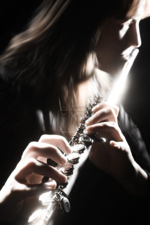 Photo for Musician performer flute playing. Flutist on the black - Royalty Free Image