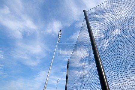 Baseball Net and Stadium Lights Abstract