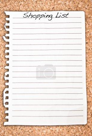 Vertical shopping list on cork background