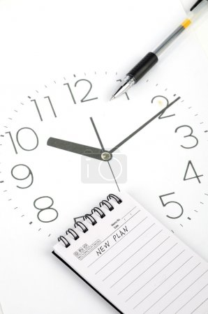 Clock face and notepad with pen