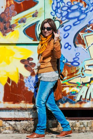 Woman at graffitti wall