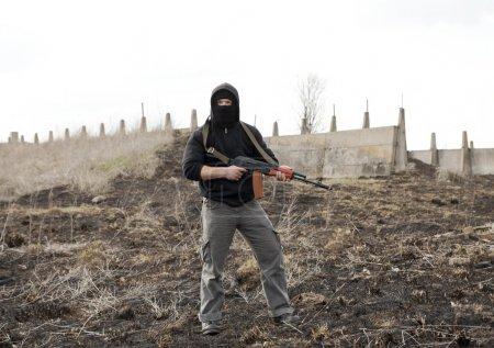 Warrior with gun in the battlefield...
