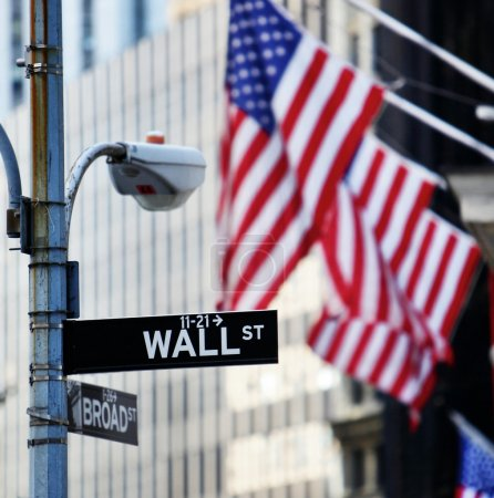 Photo for Wall street sign in New York with New York Stock Exchange background - Royalty Free Image