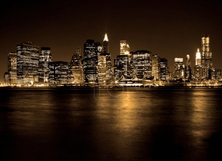 Photo for Lower Manhattan in New York City at night with reflection in water - Royalty Free Image