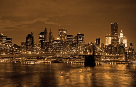 Photo for Historic Brooklyn Bridge and lower Manhattan reflected in East River - Royalty Free Image