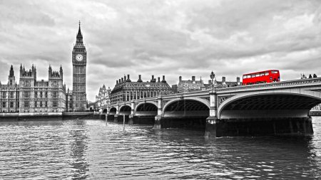 Red bus on Westminster Bridge by the Houses of Par...