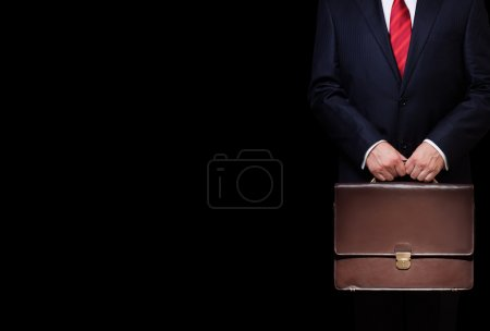 Photo for Business person holding a briefcase - Royalty Free Image