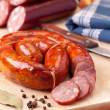 Sausage on a wooden cutting board....