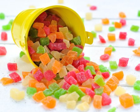 Colorful candied fruits in a small bucket