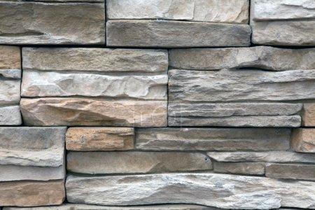 The wall of the narrow brick