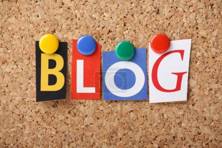 Photo for The word BLOG in cut out magazine letters pinned to a cork notice board - Royalty Free Image