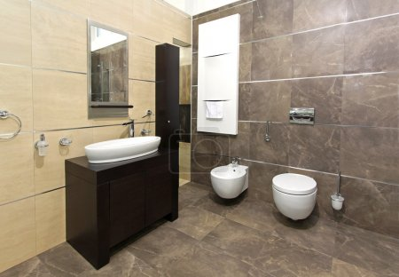 Photo for Modern bathroom interior with marble tiles and contemporary fixtures - Royalty Free Image