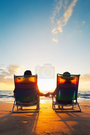 Photo for Happy Romantic Couple Enjoying Beautiful Sunset at the Beach - Royalty Free Image