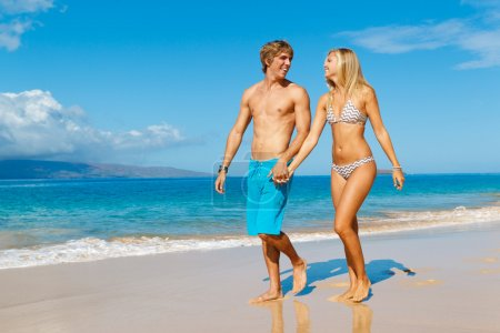 Photo for Attractive Couple Walking on Beautiful Beach - Royalty Free Image