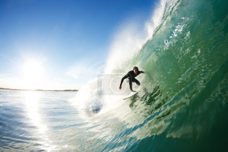 Photo for Surfer Riding Wave in the Barrel - Royalty Free Image
