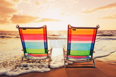 Photo for Hawaiian Vacation Sunset Concept, Two Beach Chairs at Sunset - Royalty Free Image