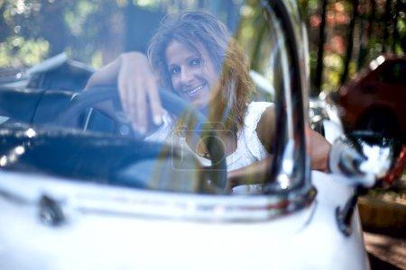 Girl in a white car
