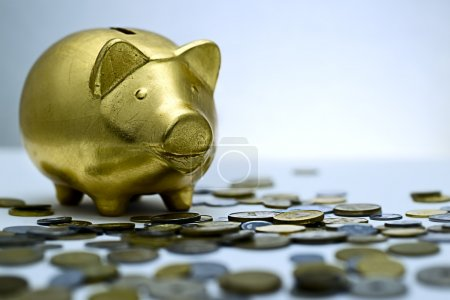 Photo for Pig piggy bank surrounded by coins - Royalty Free Image