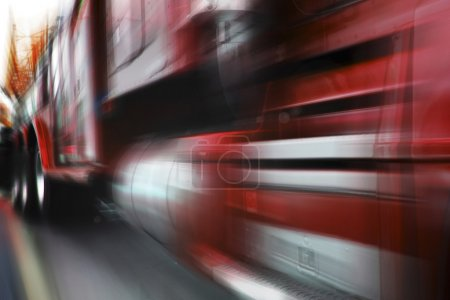 Photo of moving red truck