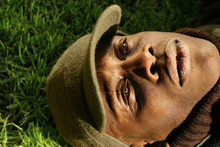 Close-up of African-American man laying on grass