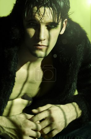 Photo for Goth man with make up in black fur - Royalty Free Image