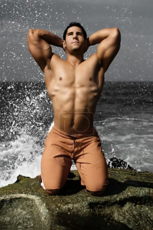 Body Builder on Beach
