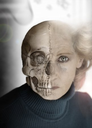 Photo for Portrait of woman with half of face as skull - Royalty Free Image