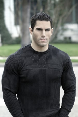 Photo for Portrait of young muscular man in black shirt outdoors - Royalty Free Image
