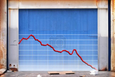 Photo for Business graph in decline on the side of an old industrial building - Royalty Free Image