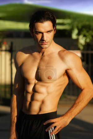 Photo for Outdoor portrait of a hunky fit male model shirtless - Royalty Free Image