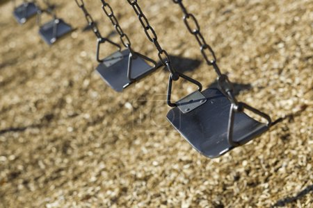 Photo for A set of empty playground swings - Royalty Free Image
