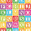 Colourful baby blocks with capital letters from A ...