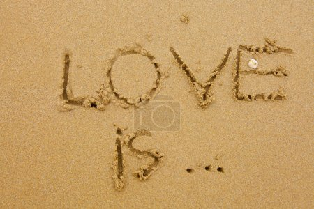 Photo for Love is inscription on the sand - Royalty Free Image