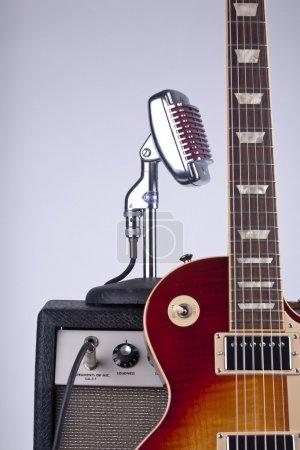 Beautiful sunburst electric guitar leaning against...