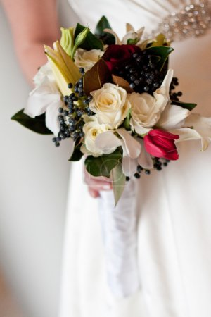Beautiful Rose Wedding Bouquet Being Held By Bride