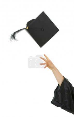 Female hand throwing up graduation cap