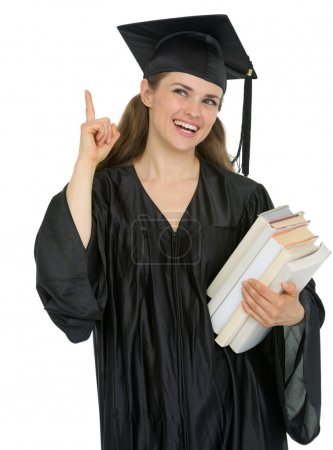 Photo for Graduation girl student with stack of books got idea - Royalty Free Image