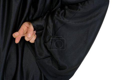 Photo pour Gros plan sur les doigts croisés cachés derrière le dos - image libre de droit
