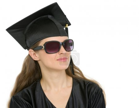 Portrait of graduation student woman in sunglasses looking on copy space