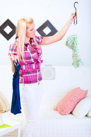 Young woman choosing what to dress