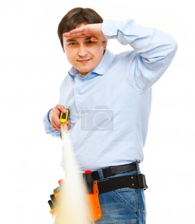 Construction worker looking into the distance on ruler