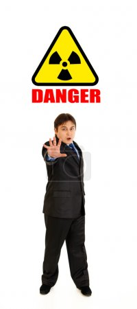 Сoncept-radiation hazard! Full length portrait of scared young businessman
